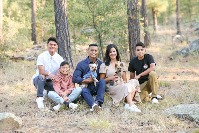 Dr. Mark Costes with his wife, three sons, and their dogs